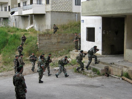 In hybrid warfare Marines will confront guerrillas, civilians and regular opposition forces in an urban environemtn, like these Lebanese troops training with U.S. Central Command. (U.S. Marine Corps photo)