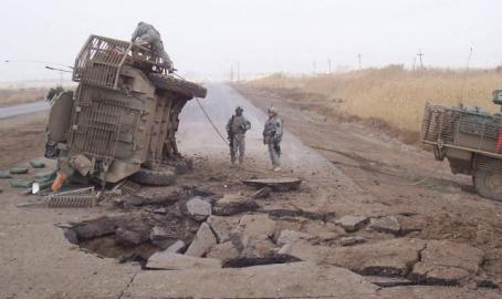 A Stryker fighting vehicle lies on its side after an IED blast in 2007. (U.S. Army photo)