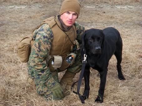 A Marine from 1st Battalion, 9th Marines, training with his improvised explosive device (IED) detection dog. (U.S. Marine Corps photo)