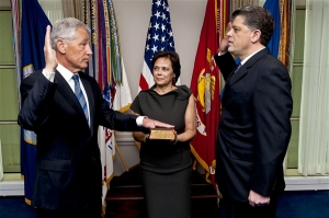 Chuck Hagel is sworn into office as the 24th defense secretary by Michael L. Rhodes, the Defense Department's director of administration and management, as Hagel's wife, Lilibet, holds a Bible at the Pentagon, Feb. 27, 2013. DOD photo by U.S. Navy Petty Officer 1st Class Chad J. McNeeley