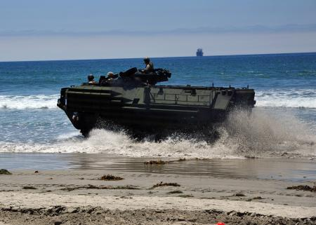 An Amphibious Assault Vehicle exits the surf during an Exercise Dawn Blitz live Maritime Prepositioning Force training event. (U.S. Navy photo by Mass Communication Specialist 2nd Class Jesse L. Gonzalez)