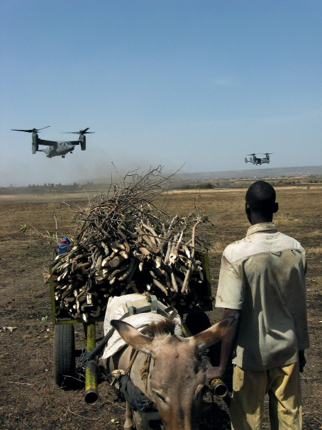 A youth watches incoming Air Force Special Operations Command CV-22 Ospreys carrying Malian and Senegalese troops near Bamako, Mali.   (U.S. Air Force photo by Capt. Bryan Purtell)
