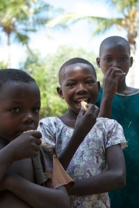 Children eating fried cassava in Tanzania (Photo by Martin Best, copyright FAO East and Central Africa)