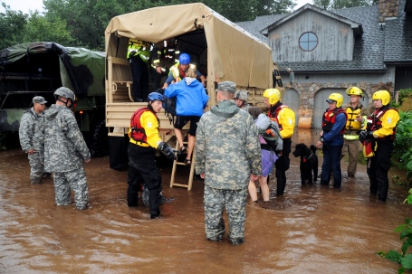 People and their pets evacuated by high clearance Army truck in Boulder County. (Army National Guard Photo by Sgt. Joseph K. VonNida)