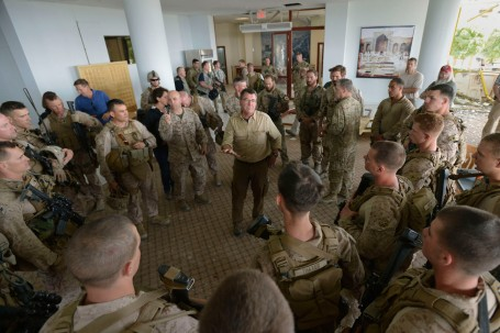 Deputy  Defense Secretary Ashton  Carter addresses troops at damaged surveys  the damage  U.S. Consulate in Herat, which fought off an attack by the Taliban.  (Defense Dept. Photo by Glenn Fawcett)