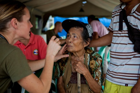 U.S. Navy Lt. Stephanie Ellis, a family practitioner with the Marine Corps 3rd Medical Battalion, examines a Filipino woman during the  cooperative health engagement at Victory Village, Albay province. (U.S. Marine Corps photo by Lance Cpl. Katelyn Hunter)