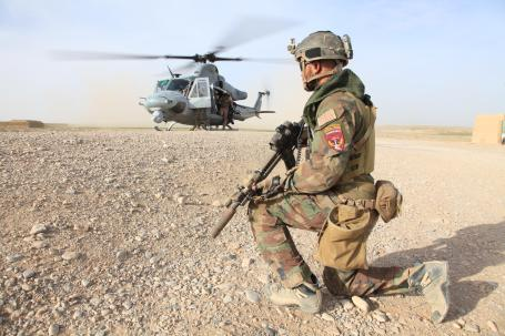 A Marine with U.S. Marine Corps Forces, Special Operations Command provides security at a landing zone in Nahr-e Saraj district, Helmand Province. (U.S. Marine Corps photo by Cpl. Kyle McNally)