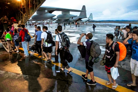 Civilians displaced by Typhoon Haiyan board a U.S. Marine Corps KC-130J Super Hercules at Tacloban Air Base, Nov. 13, before being transported to Manila.   (U.S. Marine Corps photo by Lance Cpl. Anne K. Henry)