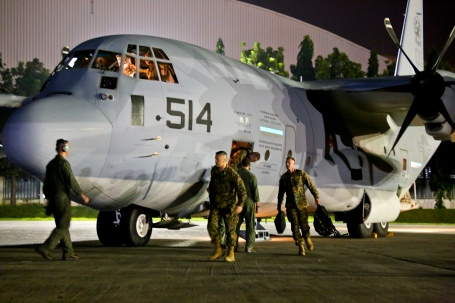 Approximately 80 U.S. Marines from the 3rd Marine Expeditionary Brigade arrive at Manila's Villamor Air Base, on two KC-130J Super Hercules aircraft to assist the Philippine government  deliver humanitarian assistance and disaster relief. ( Marine Corps photo by Capt. Joshua Diddams)