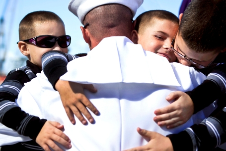 Engineman 1st Class Kevin Ives -- assigned to the guided-missile cruiser USS Princeton (CG 59) -- embraces his sons during a homecoming celebration at Naval Base San Diego. (U.S. Navy photo by Mass Communication Specialist 3rd Class Christopher Farrington)