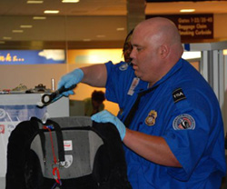 Transportation Security Officers will be at their posts if Dept. of Homeland Security funding is interrupted. (TSA photo via Wikipedia)