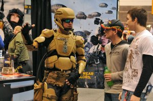 Sgt. 1st Class Matthew Oliver suits up in a futuristic combat uniform with a Tactical Assault Light Operator Suit-like look at the 2012 Chicago Auto Show.  (U.S. Army photo)