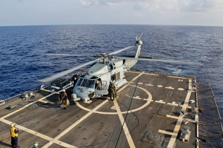 A U.S. Navy MH-60R Sea Hawk helicopter lands aboard the guided-missile destroyer USS Pinckney (DDG 91), to swap crews before resuming search and rescue operationsin the Gulf of Thailand for missing Malaysian airlines flight MH370.  (U.S. Navy photo by Senior Chief Petty Officer  Chris D. Boardman)