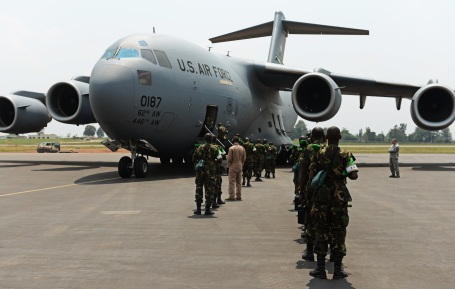 Rwandan soldiers wait in line to board a U.S. ir Force C-17 Globemaster III to deploy as peacekeepers to aid French and African Union operations in the Central African Republic.  (U.S. Air Force photo by Staff Sgt. Ryan Crane)