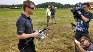 Aeryon Labs North American Sale Director Cameron Waite shows the SkyRanger minicopter to the press. (4GWAR photo by John M. Doyle)