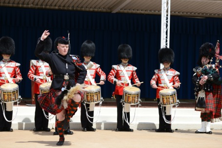 One of the two Highland dancers attached to the 1st Battalion, Scots Guards, band performs outside the Pentagon.  (Defense Dept. photo photo by Claudette Roulo)