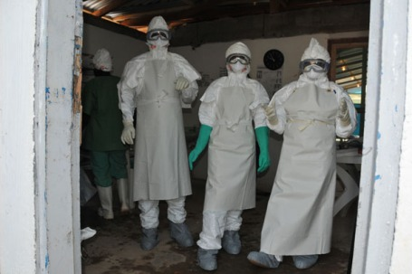 Health workers treating Ebola patients in Africa. (World Health Organization photo by Christine Banluta)