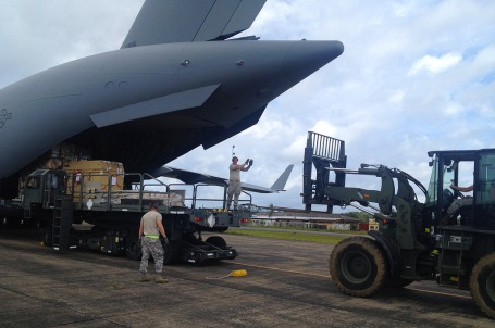 An Air Force C-17 cargo plane arrives with the first shipment of U.S. military equipment and personnel to help contain Ebola in Liberia, Sept. 23, 2014. The cargo included a heavy duty forklift, drill set and generator.  (U.S. Army Africa photo courtesy of the U.S. Embassy in Monrovia) Liberia