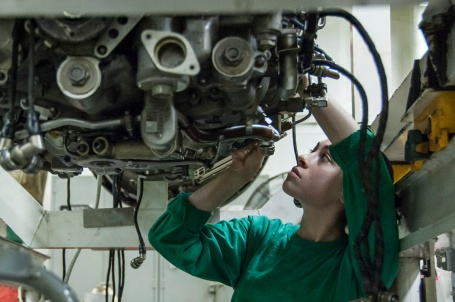 Aviation Machinist's Mate 3rd Class Catherine Byron performs maintenance on a jet engine aboard the aircraft carrier USS George H.W. Bush (CVN 77).  (U.S. Navy photo by Mass Communication Specialist 3rd Class Brian Stephens)