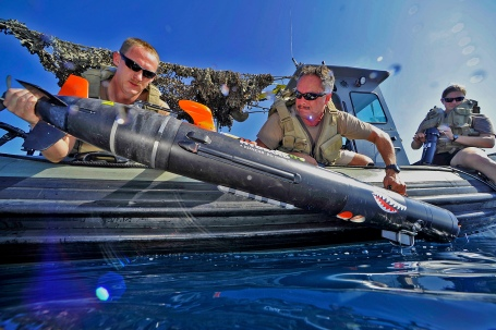 U.S. Navy sailors deploy a MK 18 MOD 2 Swordfish unmanned undersea vehicle (UUV) to survey the ocean floor during the International Mine Countermeasure Exercise . (U.S. Navy photo by Mass Communication Specialist 1st Class Blake Midnight/Released)