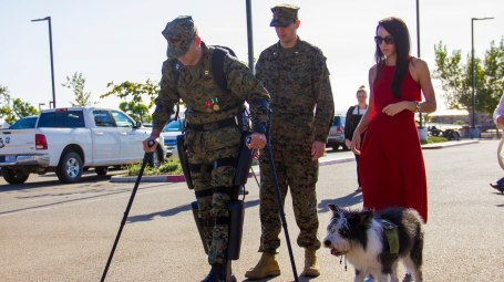 Captain Derek Herrera, of the 1st Marine Special Operations Battalion, walks with the aid of a powered exoskeleton, at his medical retirement ceremony, where he received the Bronze Star medal for heroism. Herrerra was paralyzed by a sniper bullet in Afghanistan in 2012. (Marine Corp photo by Corporal Ricardo Hurtado)