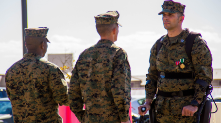 Captain Derek Herrera, (right), a special operations officer with 1st Marine Special Operations Battalion, is presented the Bronze Star Medal during a retirement ceremony at Camp Pendleton, California. Herrera was awarded the Bronze Star  with combat V for heroism for his actions in Helmand province, Afghanistan. (Marine Corps photo by Corporal Ricardo Hurtado)