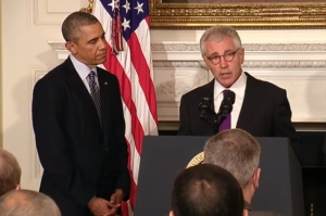 Defense Secretary Chuck Hagel discusses his resignation during a White House news conference with President Barack Obamal Nov. 24. Hagel will continue to serve as defense secretary until a successor is confirmed by the Senate.