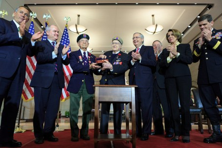 Leaders of the U.S. House and Senate present a Congressional Gold Medal to members of the First Special Service Force. From left to right: Speaker John Boehner; Canadian Minister of Veterans Affairs, Erin O'Toole;  Eugene Gutierrez, Jr.;  Charles W. Mann; Senate Majority Leader Mitch McConnell; Senate Minority Whip Dick Durbin; House Minority Leader Nancy Pelosi; and General Joseph Votel. -- (Official Photo by Caleb Smith)