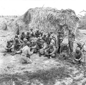 "The First Special Service Force troops, nicknamed ""Black Devils""  by the Nazis, being briefed before a night patrol at Anzio, Italy, in 1944"