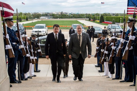 Deputy Secretary of Defense Bob Work (right) and Latvia's Minister of Defense Raimond Vejonis pass through an honor cordon in order to discuss matters of mutual importance at the Pentagon Apr. 23, 2015.  (Photo by Master Sgt. Adrian Cadiz)