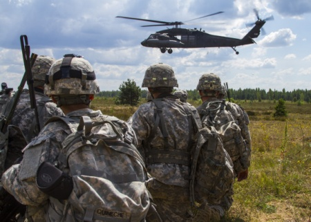 Paratroopers with the 173rd Airborne Brigade iduring a training exercise with Latvian troops to show commitment to NATO obligations and interoperability with allied forces as part of Operation Atlantic Resolve.  (U.S. Army Photo by Sergeant Michael T. Crawford)