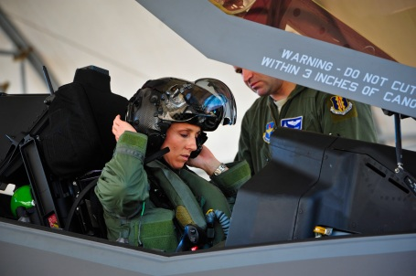 (U.S. Air Force photo/Staff Sgt. Marleah Robertson) Lt. Col. Christine Mau, 33rd Operations Group deputy commander, puts on her helmet before taking her first flight in the F-35A on Eglin Air Force Base, Fla., May 5, 2015. Mau, who previously flew F-15E Strike Eagles, made history as the first female F-35 pilot in the program. (U.S. Air Force photo/Staff Sgt. Marleah Robertson)