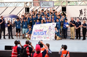 South Korea's Team KAIST after winning the DARPA Robotics Challenge. DARPA photo)