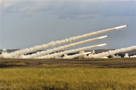 Soldiers fire missiles from a multiple rocket system, during the South Dakota Army National Guard's annual training on Camp Guernsey, Wyoming. (Defense Dept. photo)