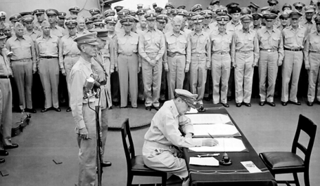 TOKYO, Japan- 2 Sep 1945- Allied sailors and officers watch General of the Army Douglas MacArthur sign documents during the surrender ceremony aboard Missouri on 2 September 1945. (U.S. Army photo)