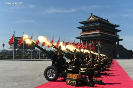 Soldiers fire a gun salute during the commemoration to mark the 70th anniversary of the victory of the Chinese victory over Japan in a war that began two years before the West errupted in World War II. (Xinhua Photo by Ren Junchuan)