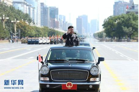 Chinese President Xi Jinping stands in a car on his way to review the army, at the beginning of the military parade marking the 70th anniversary of the end of World War Two, in Beijing, Sept 3, 2015. (Photo by Xinhua)