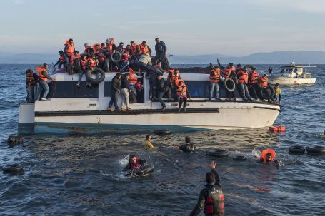 Syrian and Iraqi refugees leave a boat from Turkey on the Greek island of Lesbos. (Photo by Ggia via wikipedia)