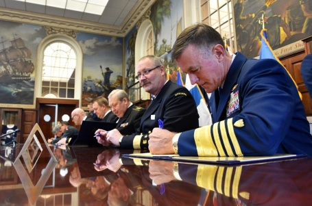 Coast Guard Commandant Adm. Paul Zukunft joins leaders from all eight coast guard agencies of the Arctic nations in to sign a Joint officially establishing the Arctic Coast Guard Forum at the Coast Guard Academy in New London, Conn. ., Oct. 30, 2015. The Arctic Coast Guard Forum is an operationally-focused, consensus-based organization with the purpose of leveraging collective resources to foster safe, secure and environmentally responsible maritime activity in the Arctic. (U.S. Coast Guard photo by Petty Officer 2nd Class Patrick Kelley)