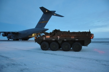 U.S. Army Alaska Stryker vehicles from Bravo Company, 3rd Battalion, 21st Infantry Regiment, 1st Stryker Brigade Combat Team, unload from an Air Force C-17 Globe master III above the Arctic Circle as part of Operation Arctic Pegasus. (U.S. Army photo by Sgt. Joel Gibson)