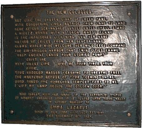 The plaque with the poem evoking the spirit of the Statue of Liberty (via wikipedia)