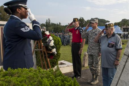 Veterans and U.S. Air Force Brigadier Generaql Barry Cornish, commander of the 18th Air Wing, salute the Prisoner of War/Missing in Action wreath during a Veterans Day ceremony on Kadena Air Base, Japan. The veterans are from Veterans of Foreign Wars Post 9723. (U.S. Air Force photo by Airman 1st Class Lynette Rolen)