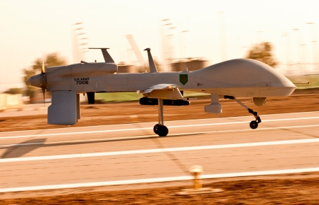 An MQ-1C Gray Eagle unmanned aircraft makes its way down an airfield in Iraq in 20xx.  (U.S. Army photo by Specialist Roland Hale)