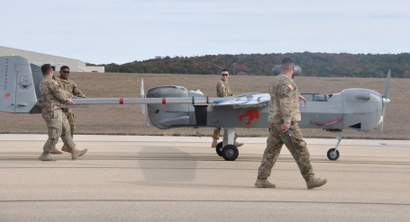 Soldiers from the 15th Military Intelligence Battalion with a Hunter unmanned aircraft system, ( UAS).  The Hunter flew its final mission at Fort Hood. (Photo Credit: Dave Conrad, Fort Hood Public Affairs)