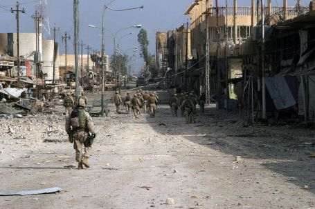 Iraqi Special Forces Soldiers and U.S. Marines patrol streets in Fallujah, Iraq in 2004. (U.S. Marine Corps photo by Lance Corporal James J. Vooris)