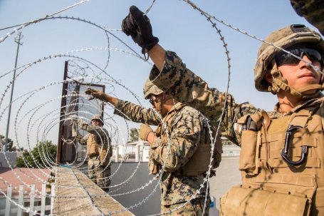 Marines string razor wire